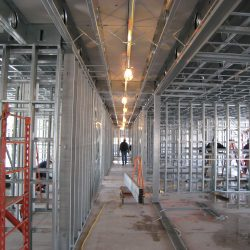 light gauge steel framing being installed by a construction crew