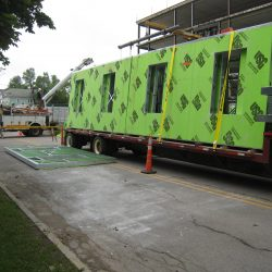 green light gauge wall panel framing on a truck