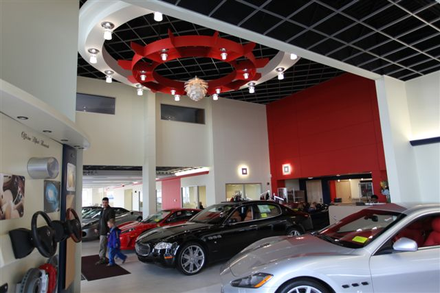ceiling clouds and prefabricated framing inside a ferrari dealership