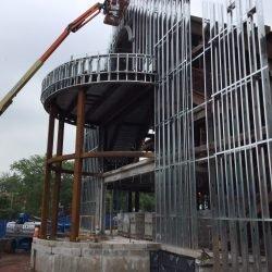 light gauge metal framed building with curved exterior canopy