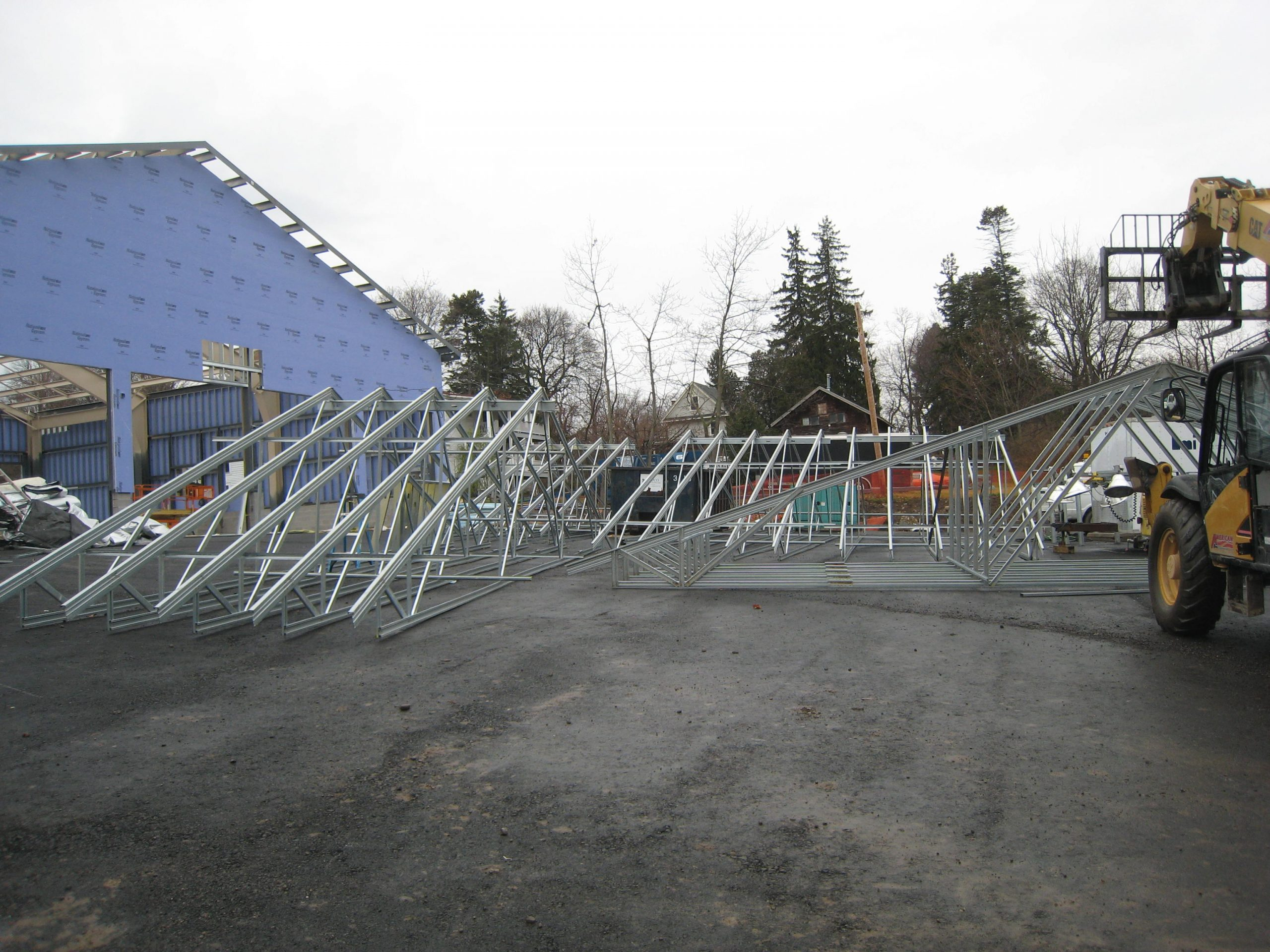 light gauge steel trusses and architectural framing being moved by forklift