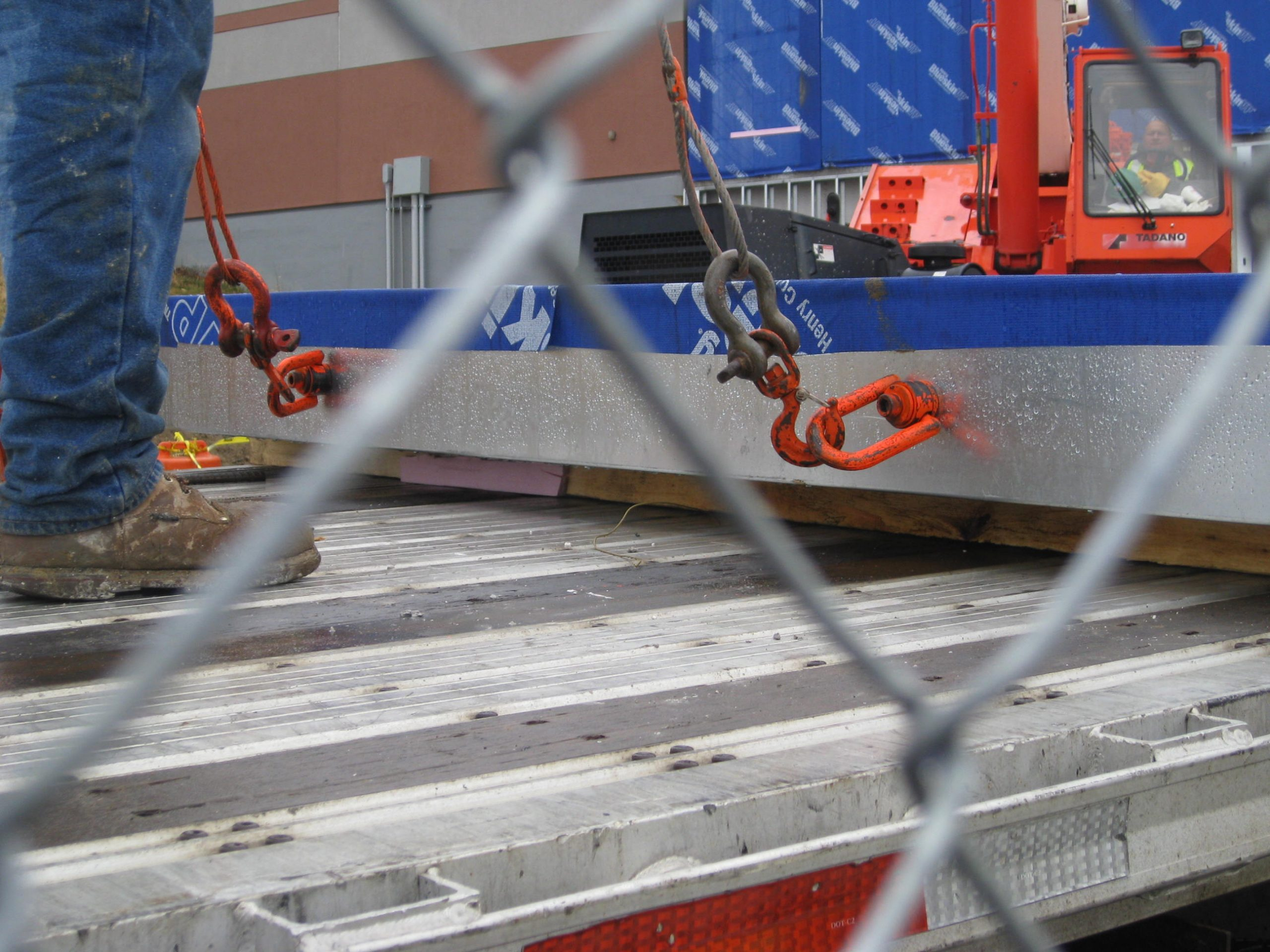 light gauge steel wall panel being moved into place by a crane