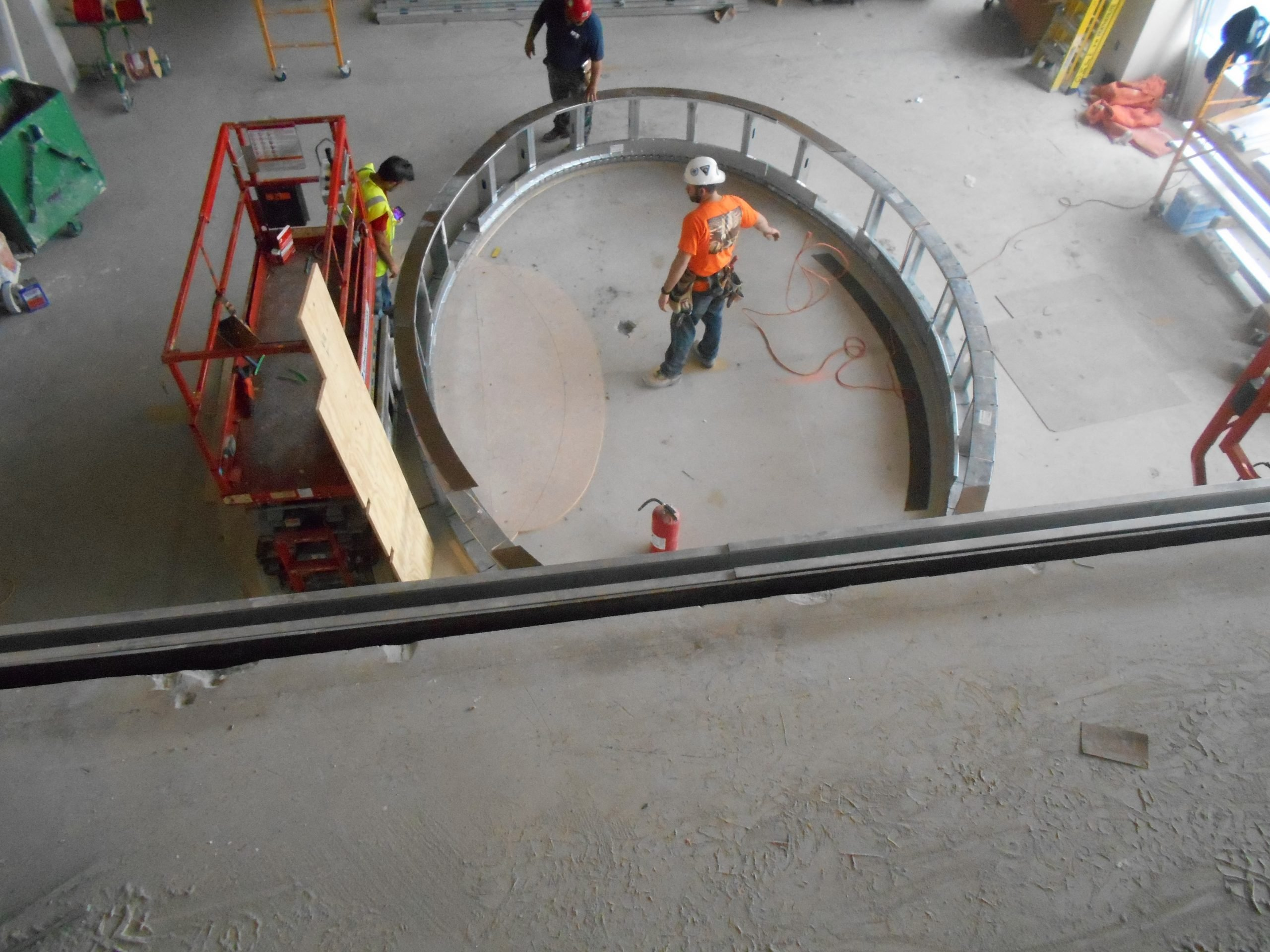 construction crew with curved steel framing